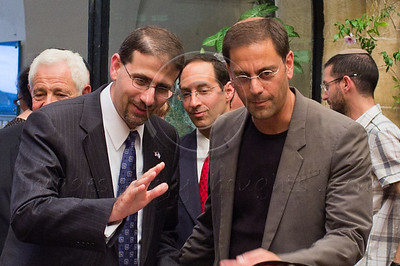US Ambassador to Israel, Daniel B. Shapiro (L) and photographer Robby Berman (R), who was at Ground Zero with his camera when the second tower collapsed, at a ceremony and photography exhibition marking a decade since the 9/11 attacks. Jerusalem, Israel. 11/09/2011.
