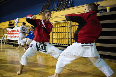 Romanian Valceanu Camelia (L) and Marincas Calin (R) warm up to perform an En-Bu Kata at the 2011 European Traditional Karate Championship hosted by the Traditional Karate Federation of Israel. Jerusalem, Israel. 17th November 2011.