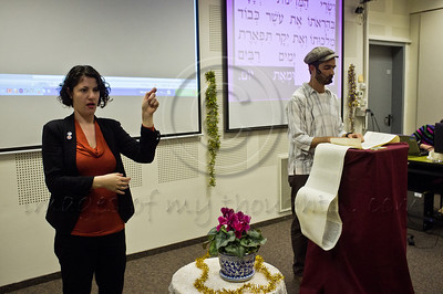 Mayor Nir Barkat takes part in a special Purim reading of the Book of Esther for the deaf and hearing-impaired at Bet Zusman, as special amplifiers are used, visual projection on screen and simultaneous sign language translation. Jerusalem, Israel. 8-Mar-2012.
