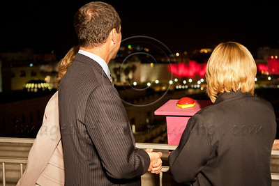 Jerusalem Mayor Nir Barkat and Julie Fisher, wife of US Ambassador to Israel, look at the pink illumination of Old City walls initiating this years Komen's Race for the Cure (May 3rd). Jerusalem, Israel. 1-May-2012.