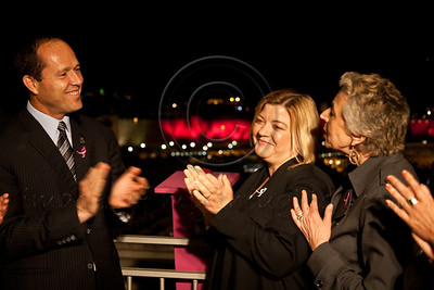 Mayor Nir Barkat (L), Julie Fisher (C), Chairperson - Israel Race for the Cure and spouse of US Ambassador, and Hadassah Lieberman (R), Consultant for Komen, applaud following illumination of Old City walls in pink. Jerusalem, Israel. 1-May-2012.