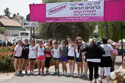 A group of young women pose for photos at entrance to Sacher Park as women of all ages and races take part in a festive celebration of femininity at Sacher Park prior to the start of Komen's second annual Israel Race for the Cure. Jerusalem, Israel. 3-May-2012.