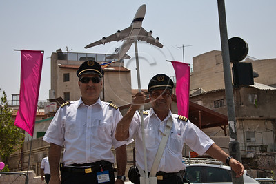 A delegation of pilots from El-Al Airlines arrives to take part in a festive celebration of femininity at Sacher Park prior to the start of Komen's second annual Israel Race for the Cure. Jerusalem, Israel. 3-May-2012.