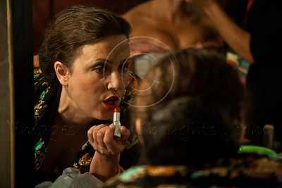 File photo: An Israeli Opera Carmen performer applies lipstick, backstage, before full dress rehearsal. Massada, Israel. 6-June-2012.