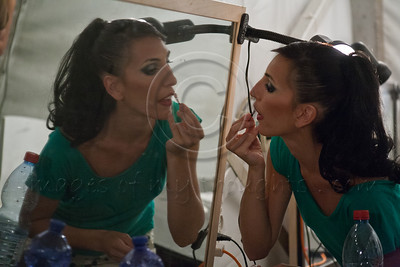 An Israeli Opera Carmen performer applies lipstick, backstage, before full dress rehearsal. Massada, Israel. 6-June-2012.