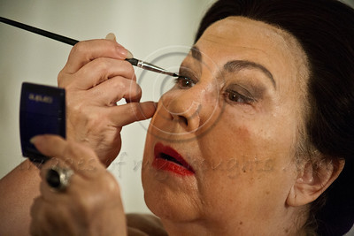 An Israeli Opera Carmen performer applies mascara, backstage, before full dress rehearsal. Massada, Israel. 6-June-2012.